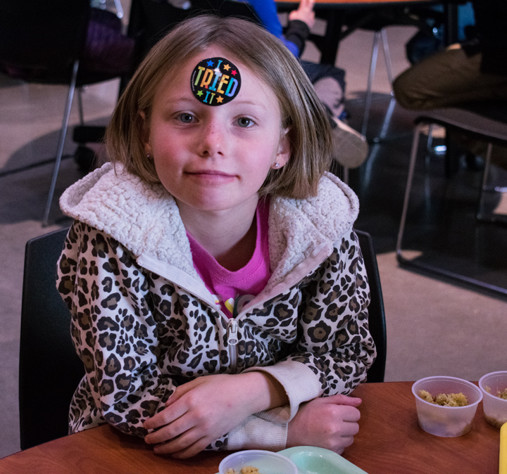 Bella Cohen proudly displays her participation in the event by placing an 'I tried it!' sticker on her forehead.