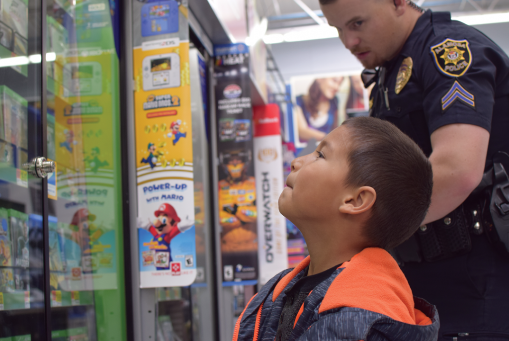 Shop with a Cop brightens Christmas for more than 20 children