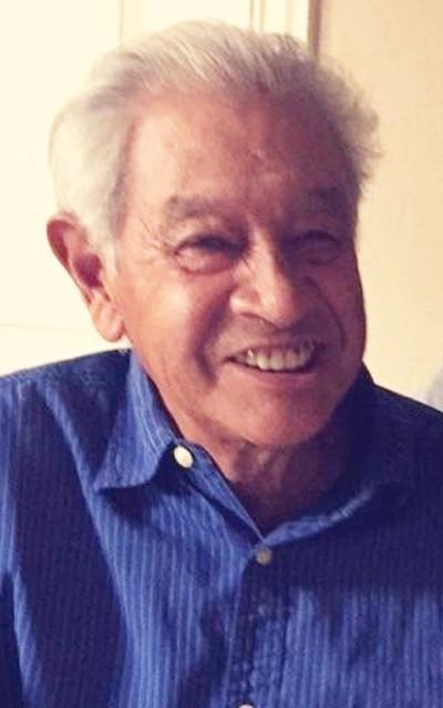 Claude Buddy DeHerrera, 74